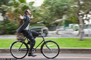 businessman-cycling-rain-hands-free